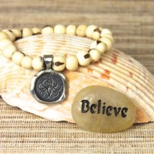 Everything Is Within Reach acai beaded bracelet with Believe talistione