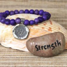Strength acai beaded bracelet with a Strength talistione