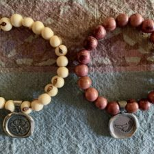 Everything is within reach and Believe beaded bracelets