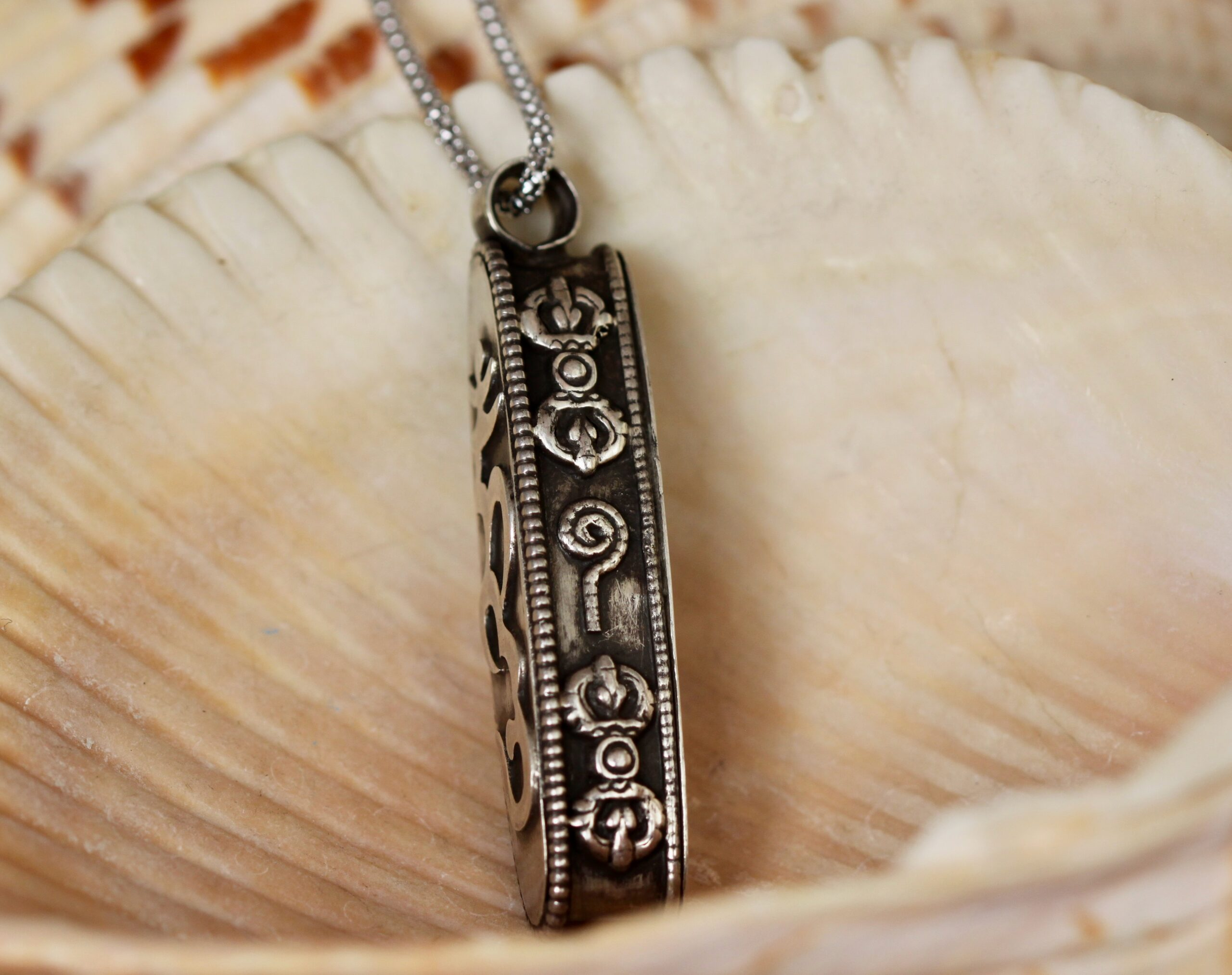 Side View of silver Om Mane Padme Hung Prayer Box necklace